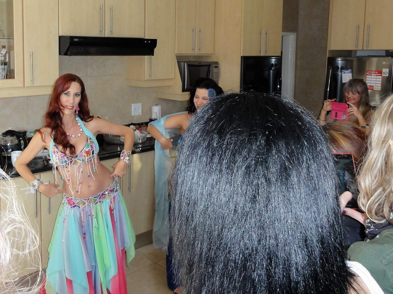 Mum to be and friends having belly dance lesson.